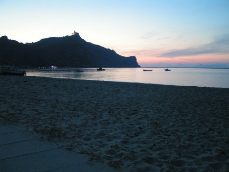 Beach in Oliveri with Tindari on the hill, Sicily, Italy